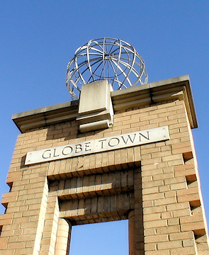 One of Globe Town's steel spheres, mounted on a brick-built arch