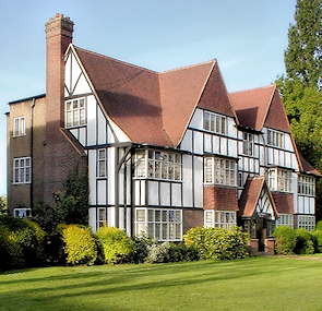 A block of flats disguised as a Tudor mansion