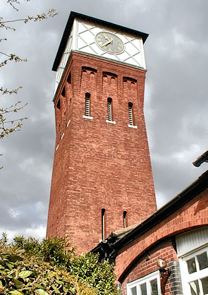 A clock-faced water tower