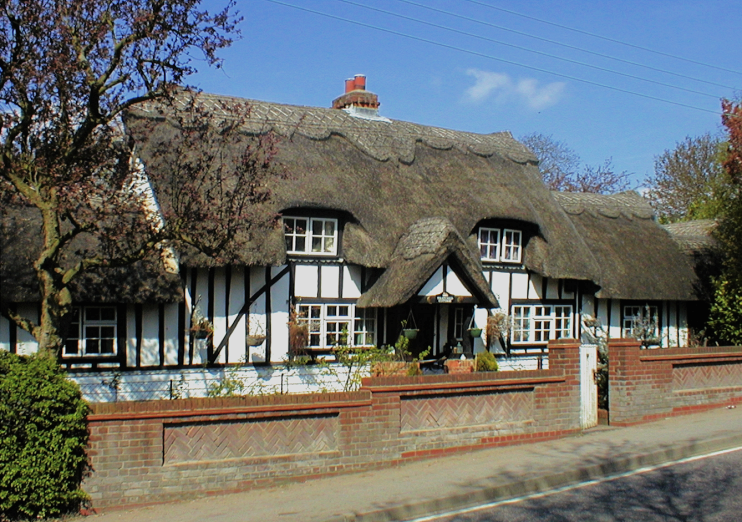 a thatched cottage on Noak Hill Road