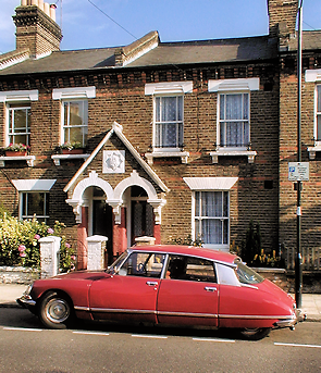 Terraced cottages with a classic Citroen DS parked outside
