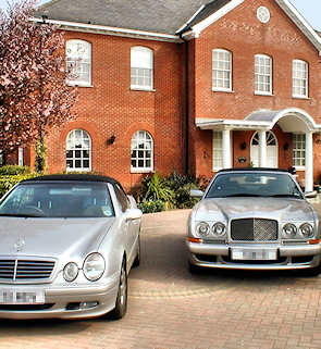 Sewardstonebury - a house and two luxury cars on Bury Road