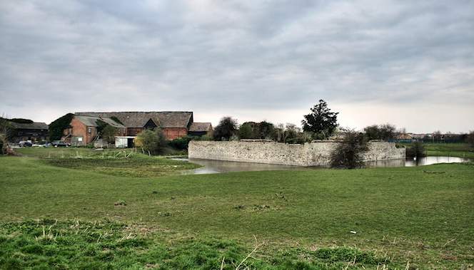 The ruins and moat of the house called Howbury, and its Jacobean tithe barn
