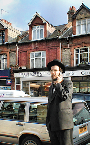 A member of the Haredim uses his mobile phone on Dunsmure Road