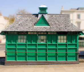 A distinctive wooden shelter, painted green