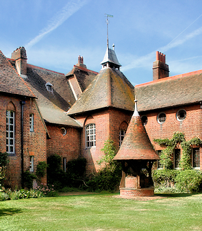 The rear of Red House, and its well