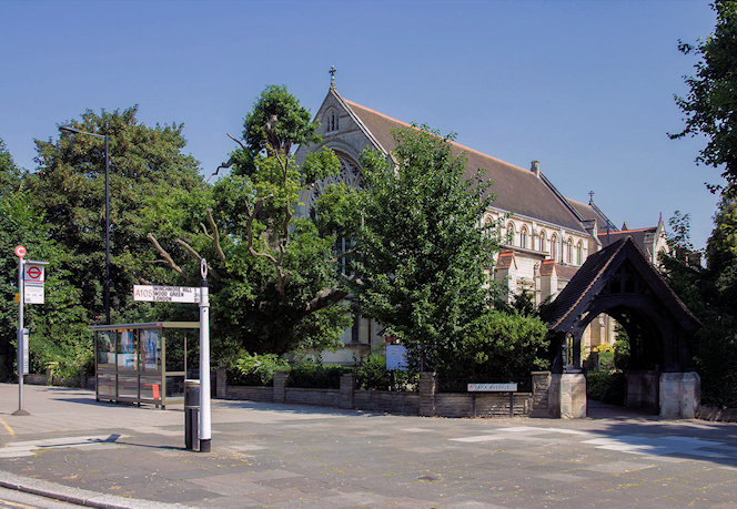 geograph-4086746-by-David-P-Howard - Finger post, bus stop and church
