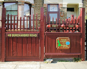 The gate of a house on Burcharbro Road, featuring aeronautical devices
