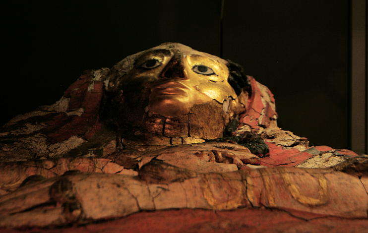 Petrie museum recumbent mummy mask, inside a glass case