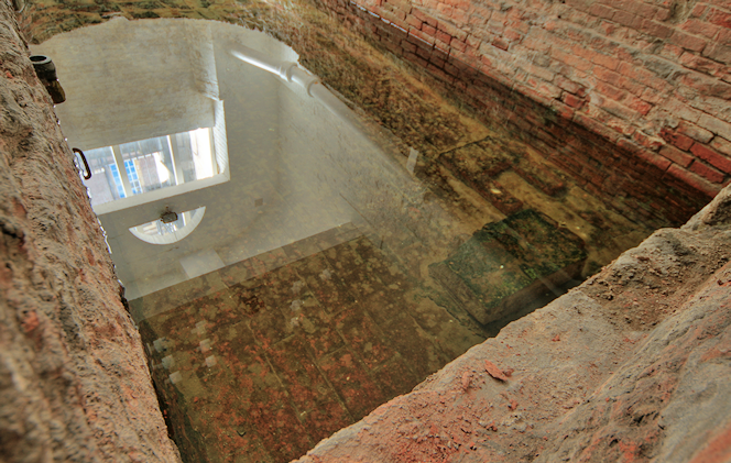 The bath has one straight end and one semi-circular end