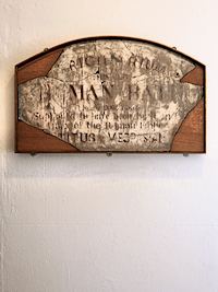A sign proclaiming the bath's Roman pedigree