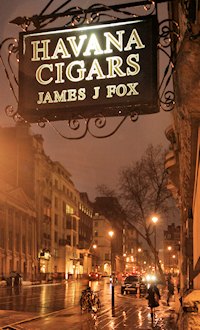 The view from Fox's doorway on a wet December evening, showing the HAVANA CIGARS sign