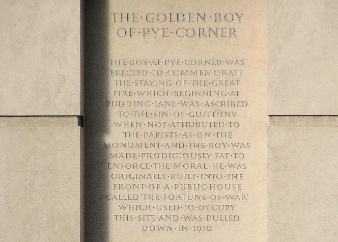 Part of the inscription beneath the gilded statue
