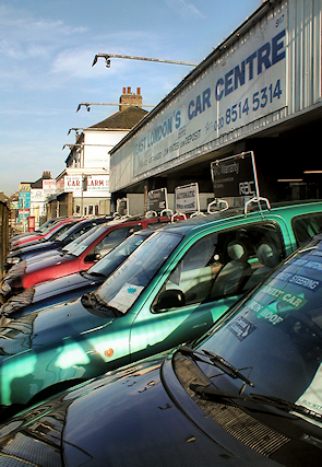 A used car dealership on Romford Road, Manor Park, seen early in the morning
