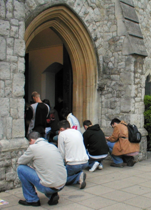 Polish worshippers unable to get inside the Catholic Church of Our Lady Mother of the Church, where it was standing room only