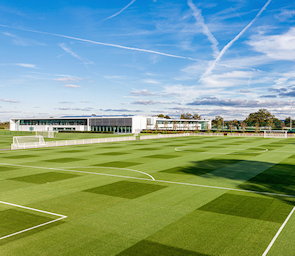 Spurs training centre, with criss-crossing contrails above, not usually seen in Enfield