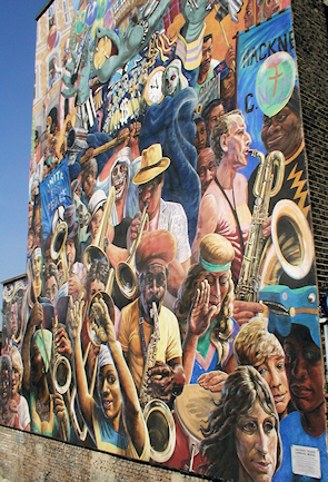 Hackney Peace Carnival mural on Dalston Lane, seen from the top deck of a passing bus