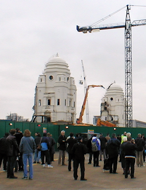 A small crowd watches the demolition of the iconic 'twin towers' of the old Wembley stadium