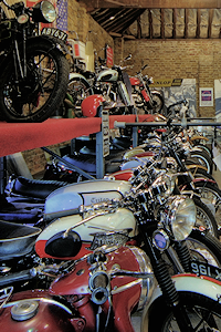 A double-​​height row of motor­cycles in the 'Triumphs only' hall at the London Motorcycle Museum
