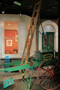 Re-creation of an Edwardian house, with a lamplighter's cart in the foreground