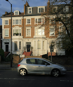 Terraced residences on Abbey Road opposite the junction with Abbey Gardens, seen just before sunset in winter
