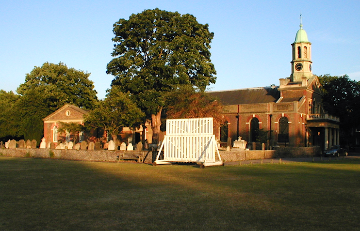 Kew Green, St Anne's church and a cricket sightscreen