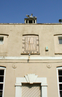A sundial on a Belhammonds (Harefield Park) stable block, surmounted by a small cupola supporting a coroneted displayed eagle