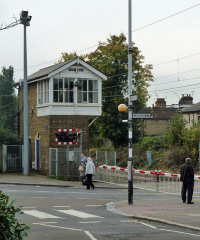 Level crossing and disused but preserved signal box south of Highams Park station