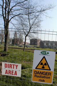 signs saying 'dirty area' and 'danger: radiation risk'