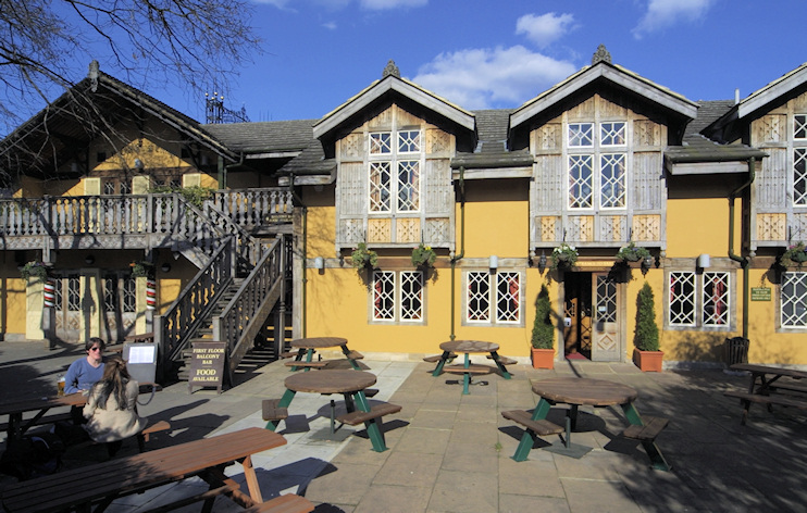Hidden London: The Old Swiss Cottage public house, in Swiss chalet style, painted yellow. This is a Sam Smith's public house, so no link can be provided as this brewery doesn't do t'internet.