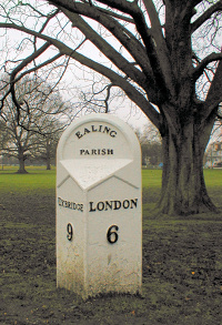 Hidden London: A milepost at the edge of a muddy Ealing Common, seen on a dull day