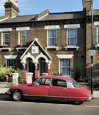 Hidden London: Terraced cottages with a classic Citroen DS parked outside