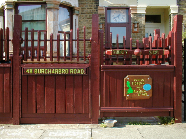 Hidden London: The gate of a house on Burcharbro Road, featuring aeronautical devices