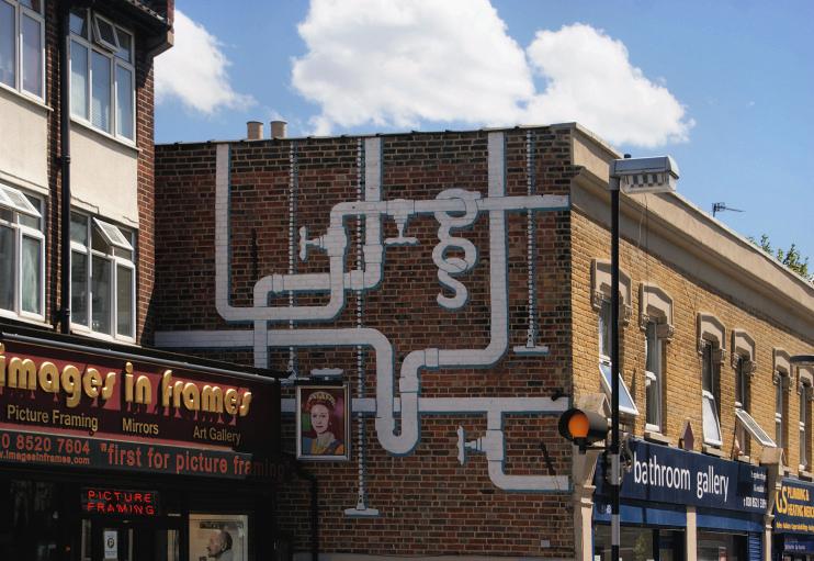 Hidden London: View of plumbing-themed street art on the side of Bathroom Gallery on Wood Street, by Robert Lamb